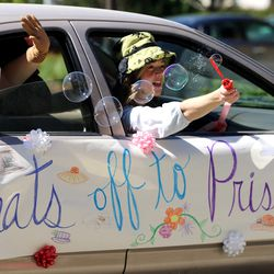 Katelyn Pettit, Jann Campbell and Carolyn Spencer wave at their grandmother, Priscilla Cahoon, while she and residents at The Ridge Cottonwood senior living center in Holladay enjoy family members display signs, balloons and waves during a Mother's Day parade on Saturday, May 9, 2020.
