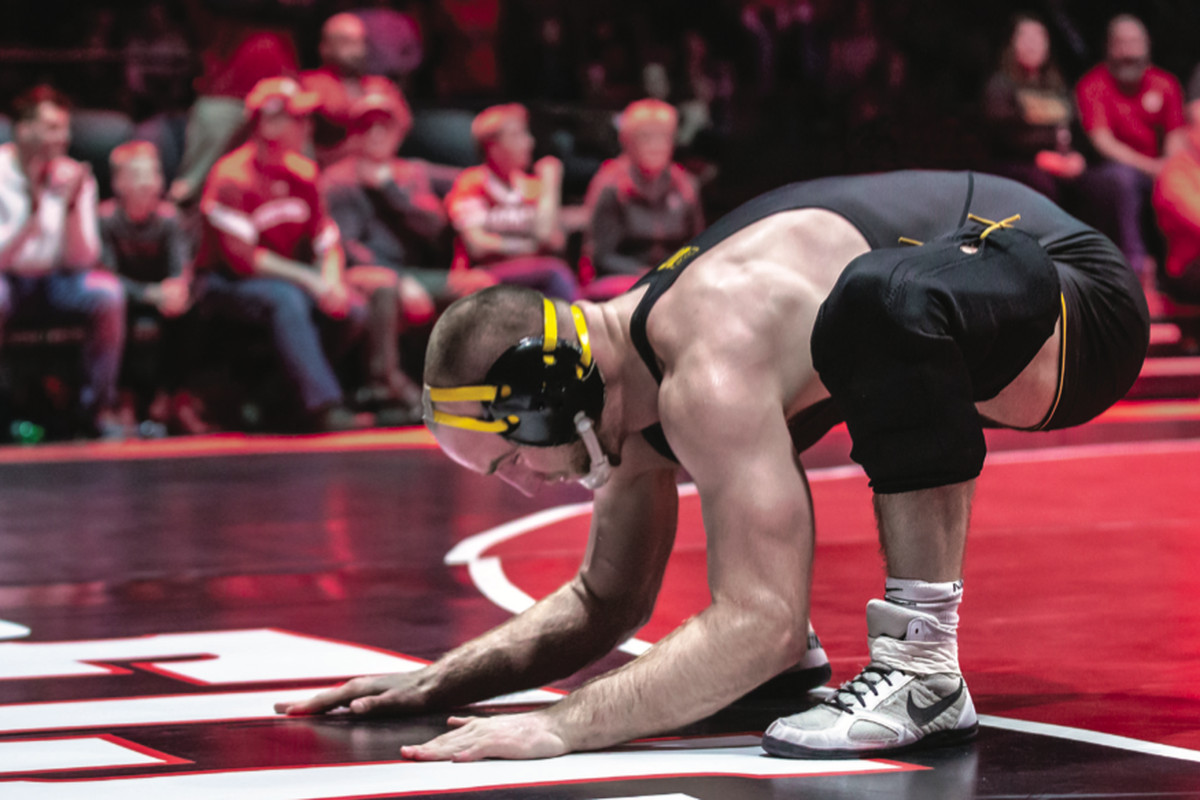 9ac457d38d3 Marinelli pays tribute to fallen wrestler and friend, Eli Stickley, during  the Wisconsin dual. Stacy Schiesl Photography