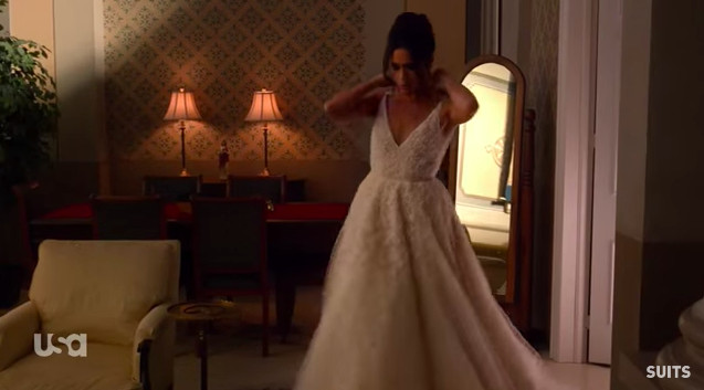 Markle, in character, is wearing her first wedding dress on suits.