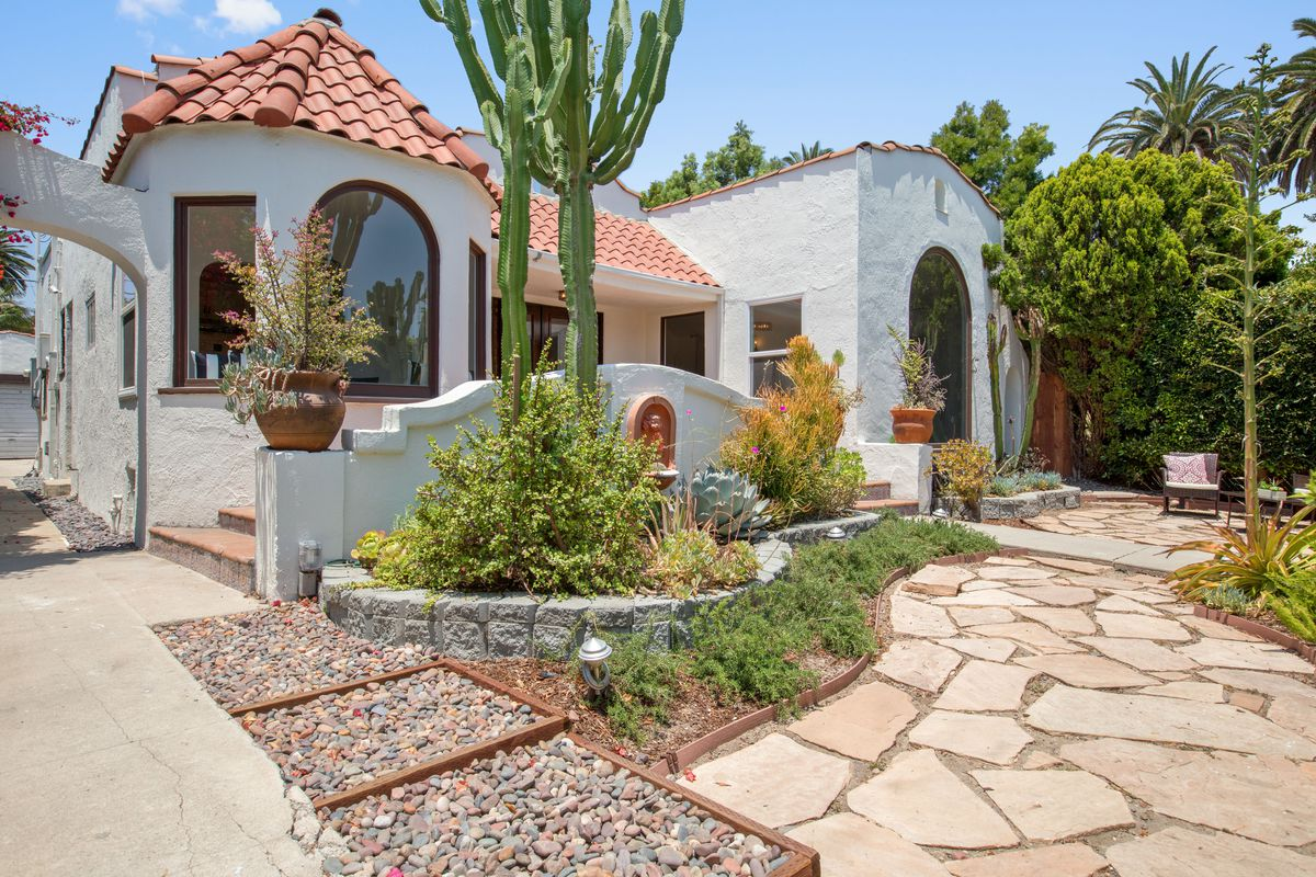 Spanish style house with sun room asks 719k in mid city for Spanish style homes for sale