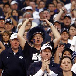 BYU fans react during NCAA football against Boise State in Boise, Thursday, Sept. 20, 2012.
