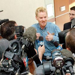 """""""Super"""" Dell Schanze interacts with a wide range of emotions to the press shortly following his sentencing on Aug. 9, 2006.  His attorney, Michael D. Bassett, stands to the right of Schanze."""
