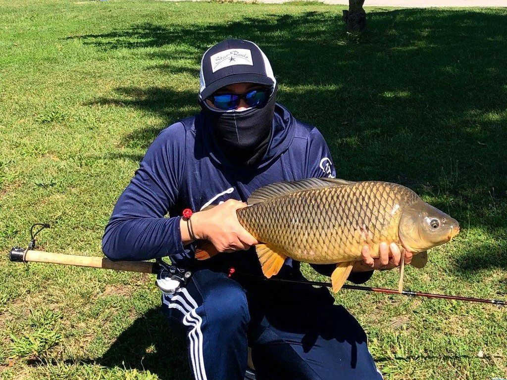 """While waiting on Chinook to come on shore, Jason """"Special One"""" Le has had success with the other big fish on the Chicago lakefront, carp. Provided photo"""