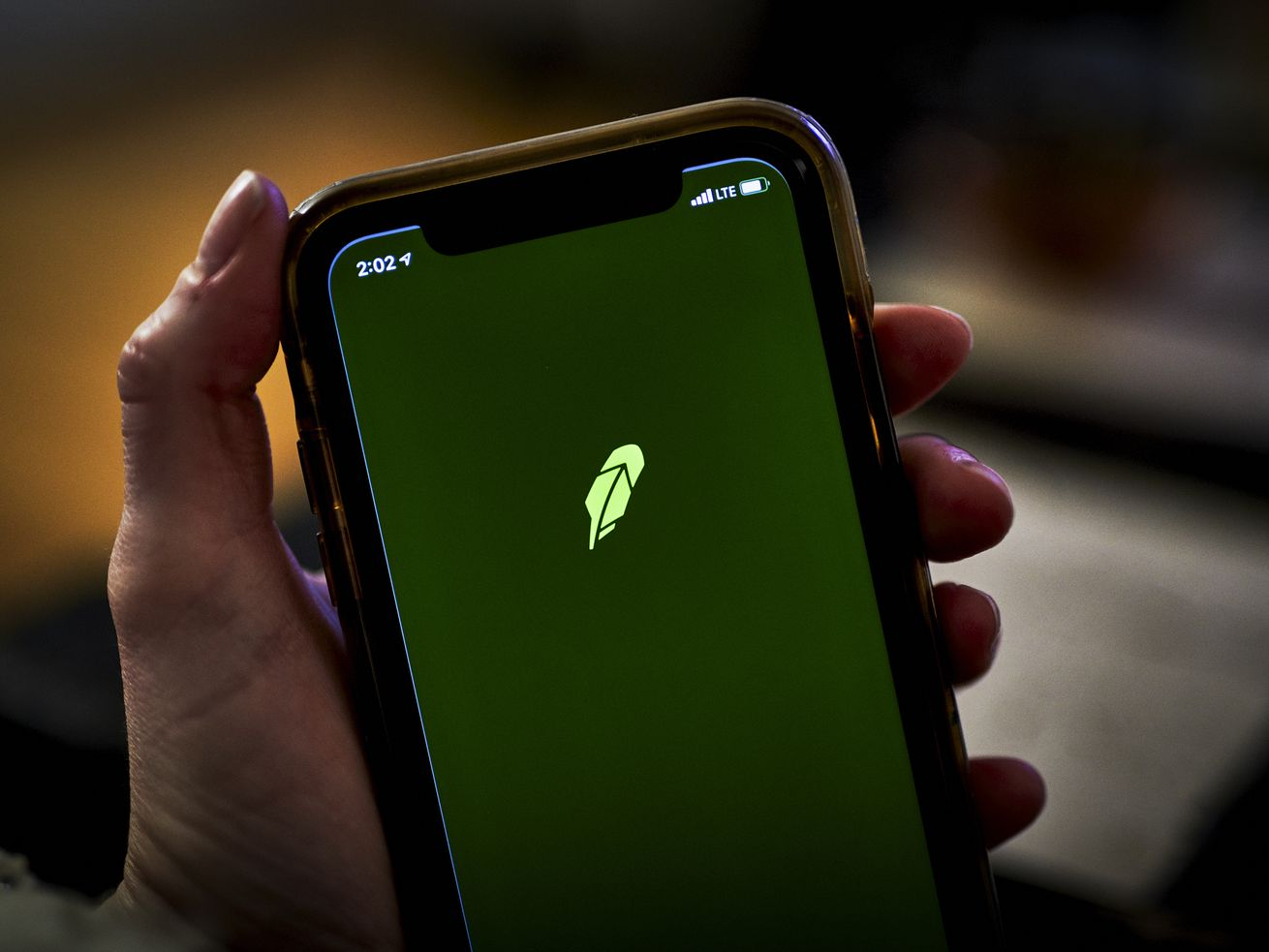The Robinhood app displayed on a smartphone screen held in a person's hand.