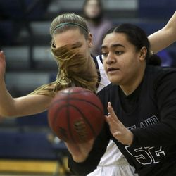 Skyline's Clara Love's hair flips into her face as she tries to guard Highland's Liliana Fifita during a game at Skyline High School in Salt Lake City on Tuesday, Feb. 16, 2021.