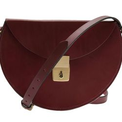"""If ever a bag could make you look put-together, it's this one. Lizzy Disney <a href=""""http://www.farfetch.com/shopping/women/lizzy-disney-lock-bag-item-10502066.aspx"""">Lock bag</a>, $565."""