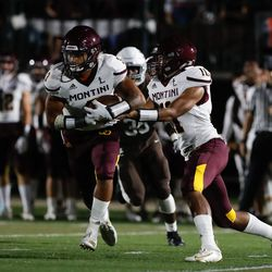 Montini's CJ Bufkin (3) runs with the ball during the game against Mount Carmel.