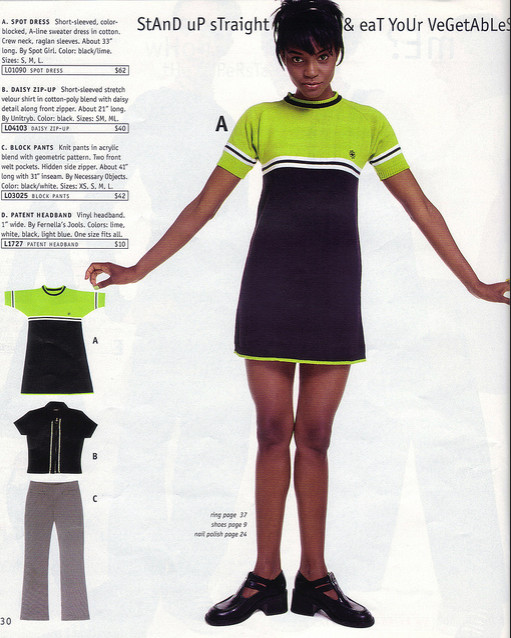 A model wears a green and black sweater dress.