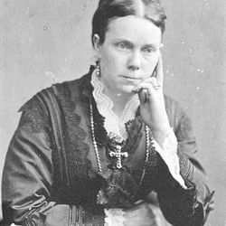 Amelia Young, widow of President Brigham Young, wears a cross in this photograph taken in 1895.
