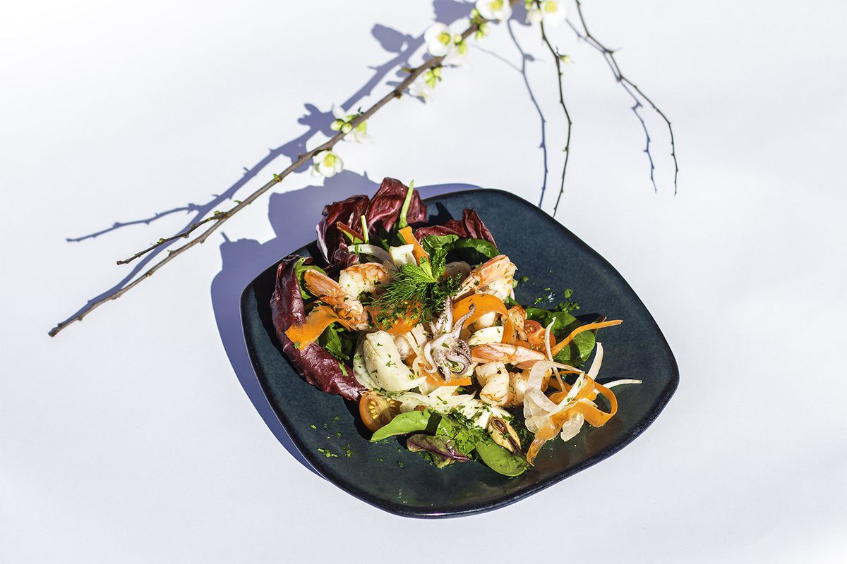 A colorful food dish with seafood.