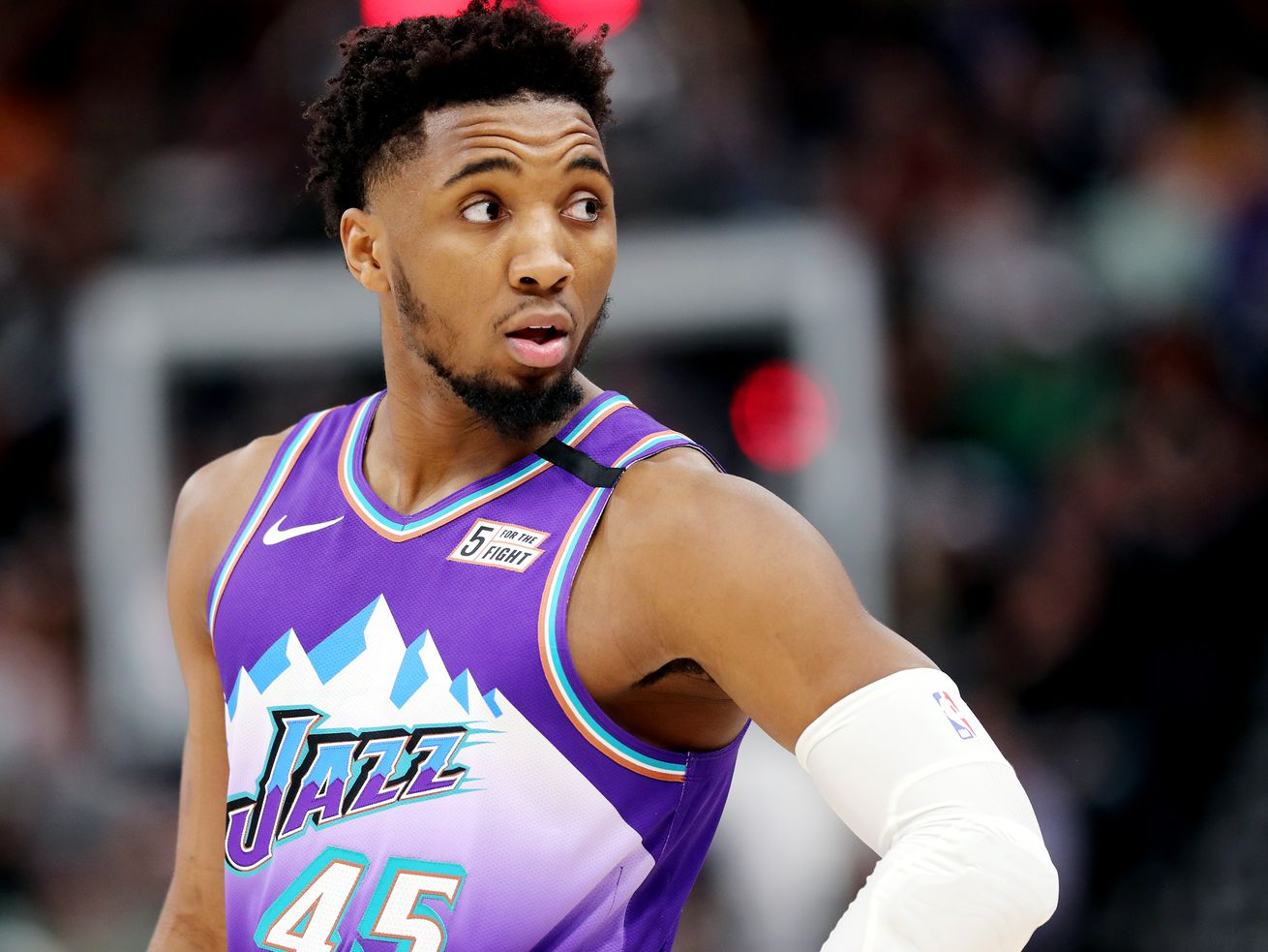 Utah Jazz guard Donovan Mitchell (45) looks into the fans as the Utah Jazz and the Boston Celtics play an NBA basketball game at Vivint Arena in Salt Lake City on Wednesday, Feb. 26, 2020.