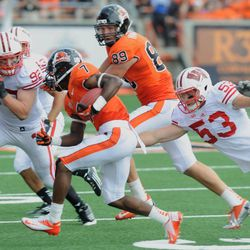 Oregon State's Brandin Cooks (7) runs against Wisconsin's Mike Taylor (53) and Pat Muldoon (92) during the second half of their NCAA college football game in Corvallis, Ore., Saturday Sept. 8, 2012.
