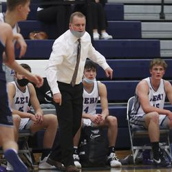 Lehi coach Quincy Lewis instructs players against Westlake in the Corner Canyon tournament in Draper on Thursday, Dec. 3, 2020.