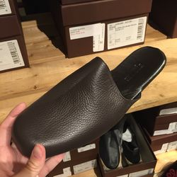 Leather slippers, $189