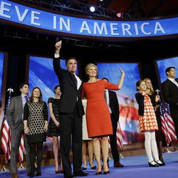 Standing with their families, Republican presidential candidate and former Massachusetts Gov. Mitt Romney stands with his wife Ann, and Republican vice presidential candidate Rep. Paul Ryan, R-Wis., second right, stands with his wife Janna after Romney's concession speech at his election night rally in Boston, Wednesday, Nov. 7, 2012.