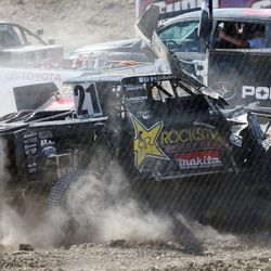 Rob MacCachren in the 21 Rockstar truck crashes into the barrier after trying to drive with his front cover blocking his view as racers compete in the Pro 2 division in the Lucas Off-Road races in Tooele on Saturday, June 24, 2017.