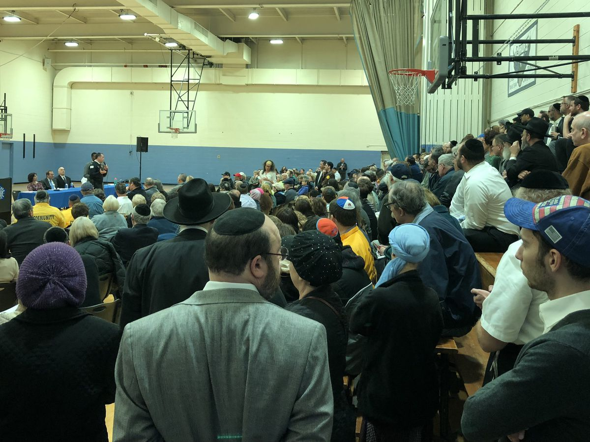 More than 200 West Rogers Park residents packed into the Bernard Horwich Jewish Community Center on Thursday for an update from police on the Rogers Park murders. | Mitchell Armentrout/Sun-Times