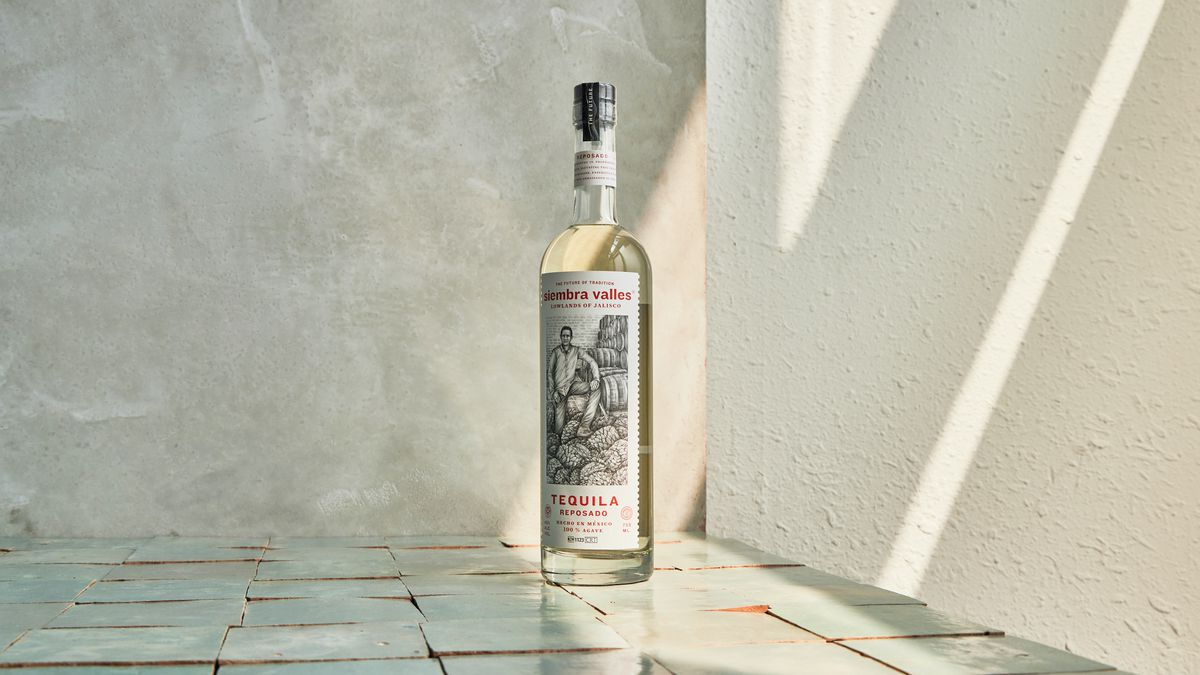 A bottle of tequila with an illustration of a man in black and white