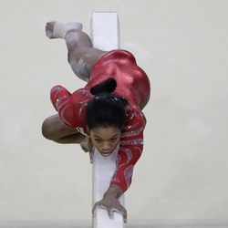 The United States' Gabrielle Douglas trains on the balance beam ahead of the 2016 Summer Olympics in Rio de Janeiro on Aug. 4, 2016.