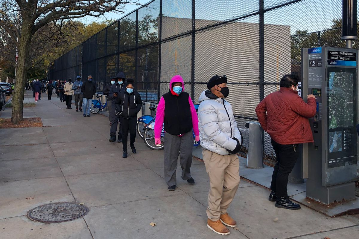 People line up to vote in Bed-Stuy, Brooklyn on Election Day, Nov. 3, 2020.