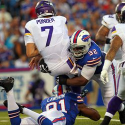 Aug 16, 2013; Orchard Park, NY, USA;  Minnesota Vikings quarterback Christian Ponder (7) gets sacked by Buffalo Bills defensive end Alex Carrington (92) and outside linebacker Manny Lawson (91) during the first half at Ralph Wilson Stadium.