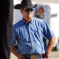 Darius Simons waits to pick up his horse Friday at the Extreme Mustang Makeover Competition in Herriman. In the competition, 34 horse trainers from multiple states pick up a preselected wild horse to be trained over the course of the next 90 days.