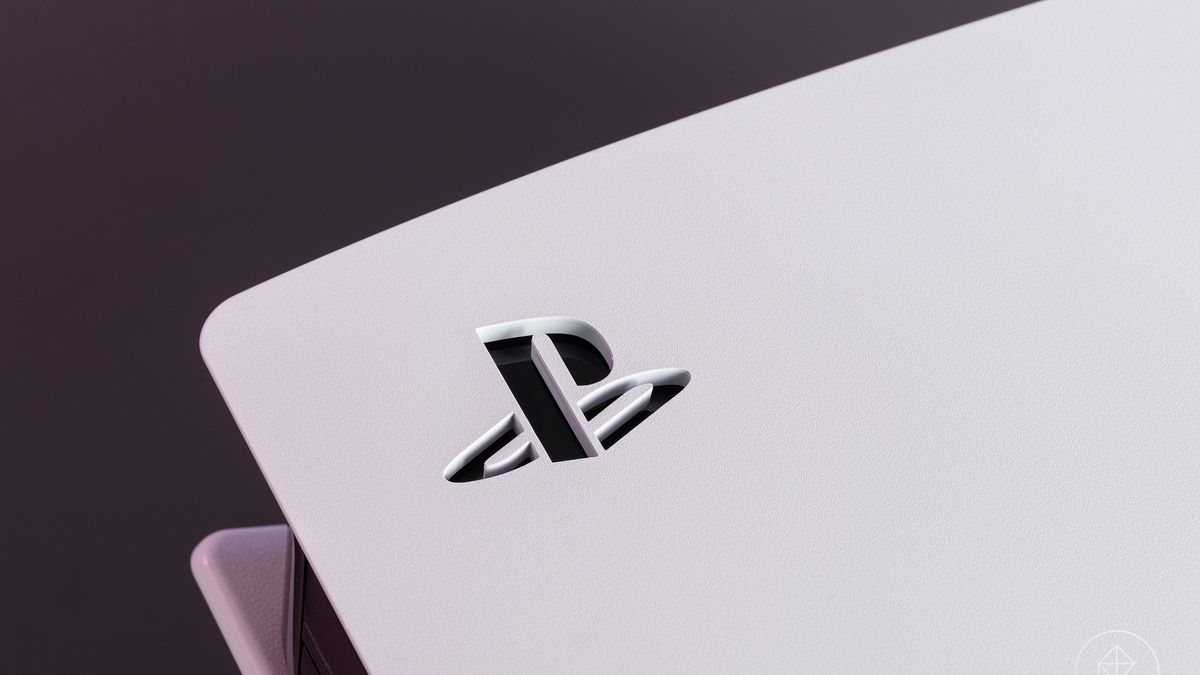 A close-up of the stenciled PlayStation logo on the white side panel of the PS5