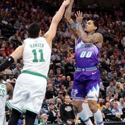Utah Jazz guard Jordan Clarkson (00) puts up a shot over Boston Celtics center Enes Kanter (11) as the Utah Jazz and the Boston Celtics play an NBA basketball game at Vivint Smart Home Arena in Salt Lake City on Wednesday, Feb. 26, 2020. Boston won 114-103.