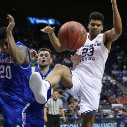 The ball goes out of bounds as Texas Arlington Mavericks forward Julian Harris (20) and Brigham Young Cougars forward Yoeli Childs (23) fall as BYU and the University of Texas at Arlington play in NIT basketball action at the Marriott Center in Provo, Utah on Wednesday, March 15, 2017.