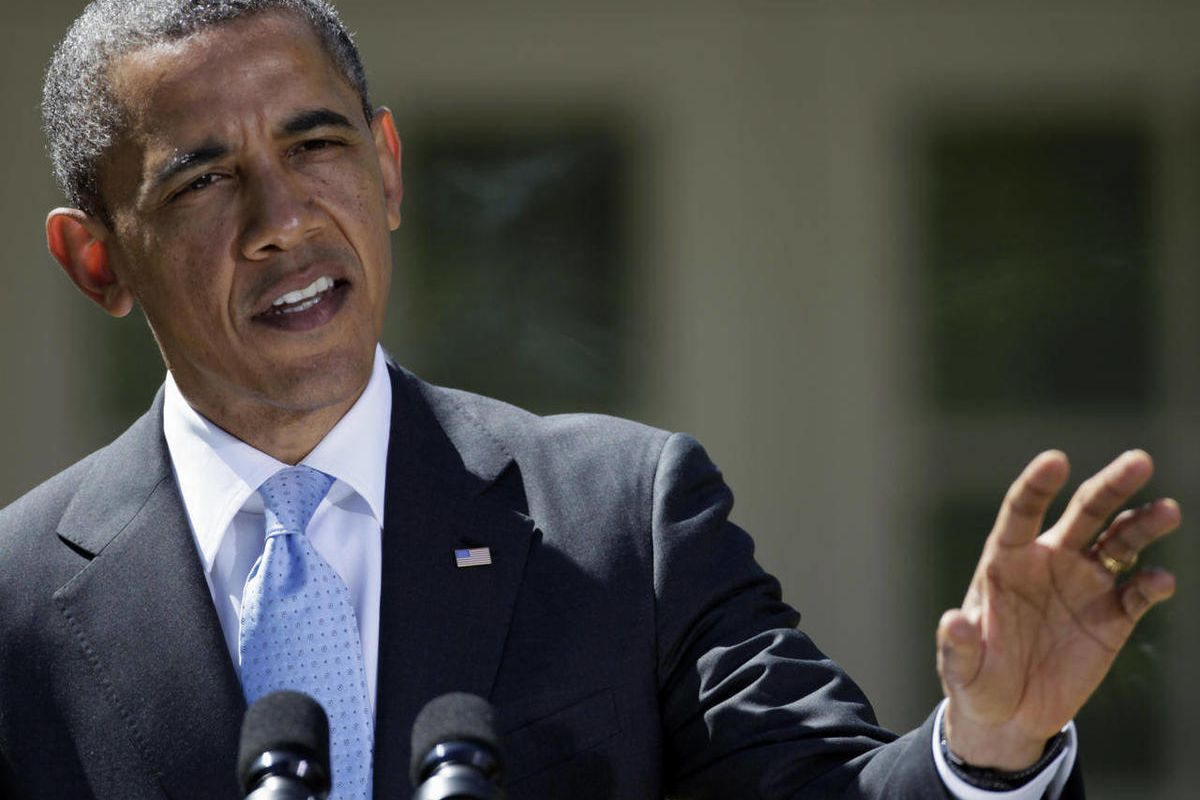 President Barack Obama gestures during his joint news conference with  Canadian Prime Minister Stephen Harper, and Mexican President Felipe Calderon, Monday, April 2, 2012, in the Rose Garden at the White House in Washington.