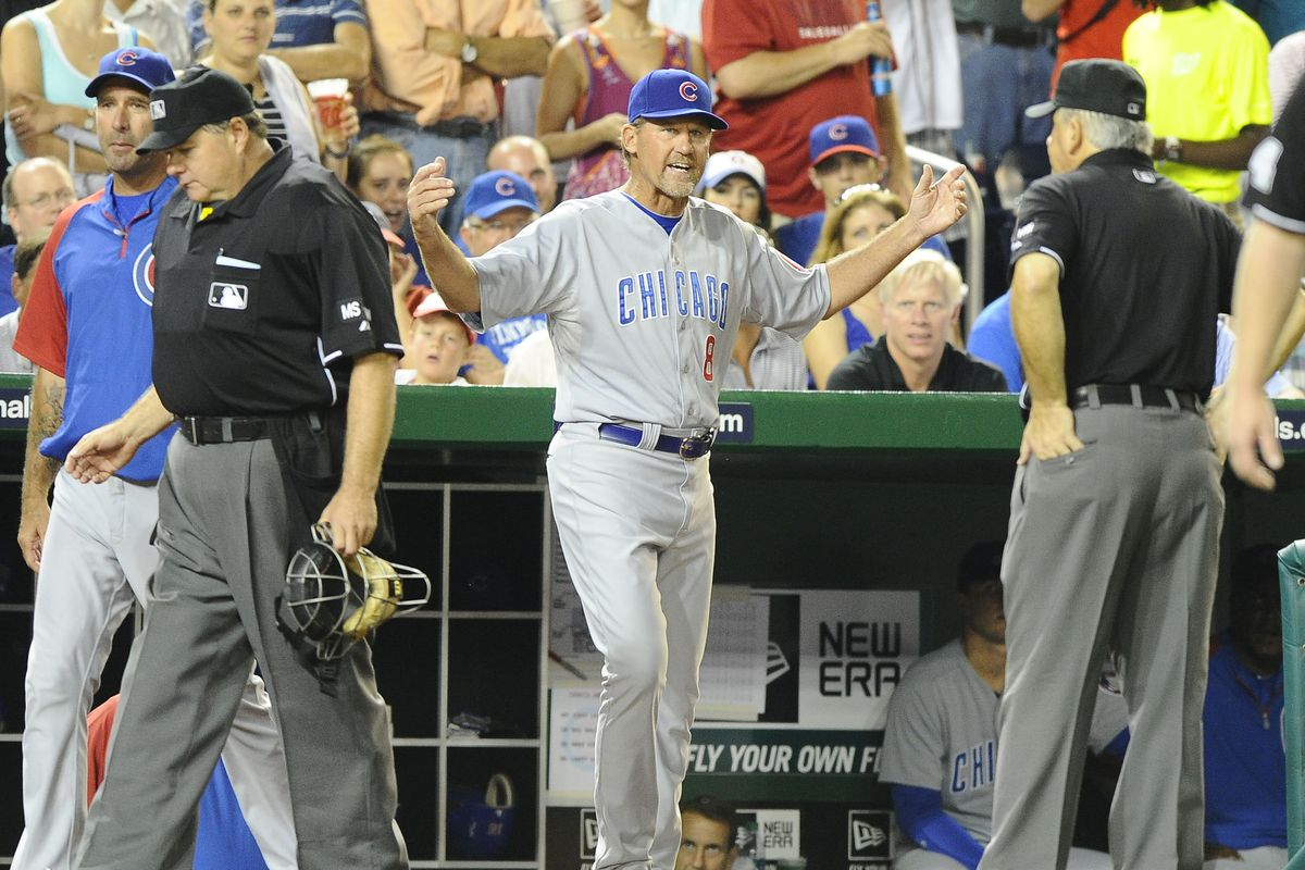 Washington, DC, USA; Chicago Cubs bench coach Jamie Quirk argues with the umpires after being ejected from the game against the Washington Nationals at Nationals Park. Credit: Brad Mills-US PRESSWIRE