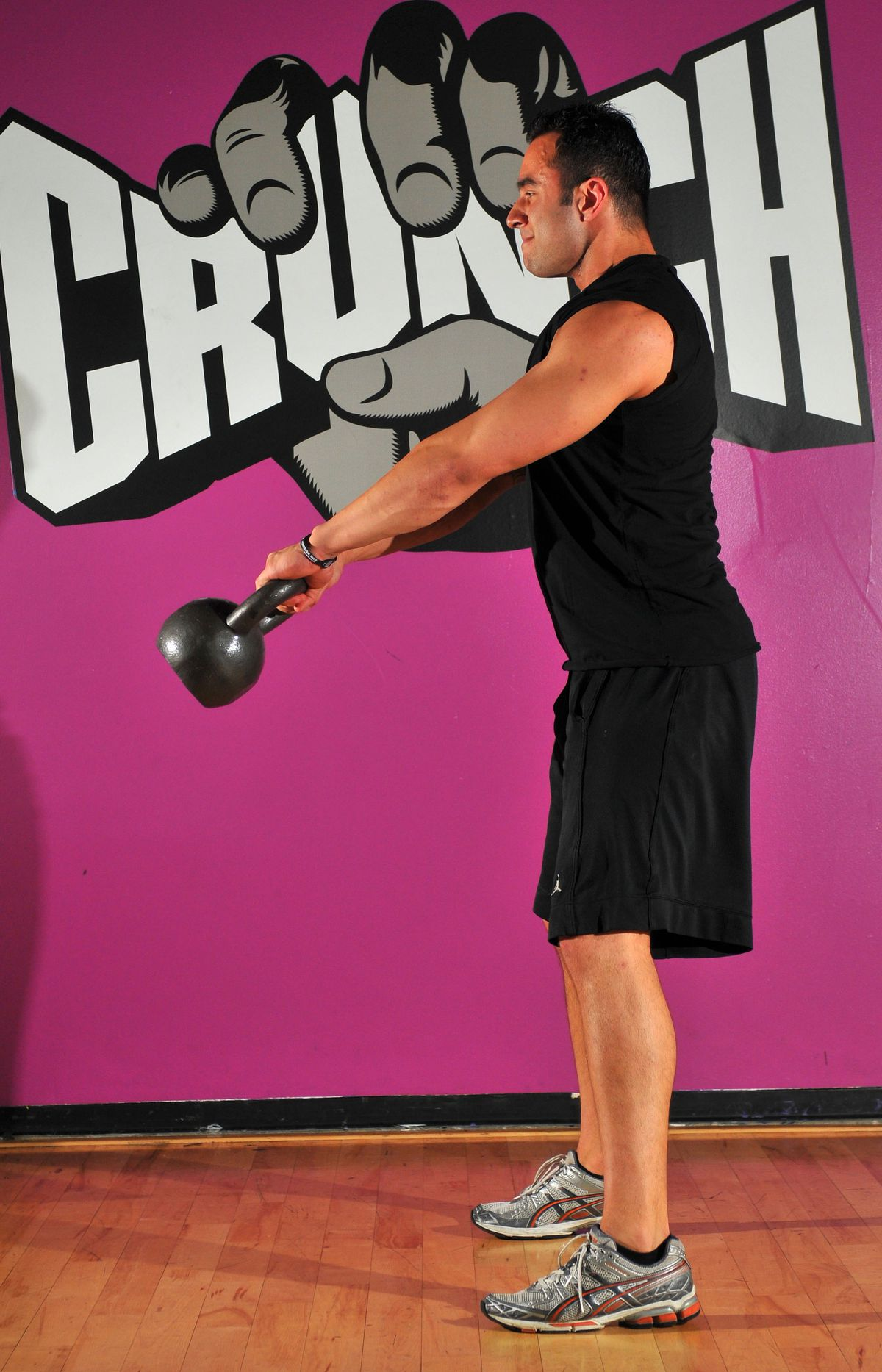 A man exercising at Crunch gym