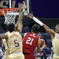 Washington forward Hameir Wright (13) and guard Jamal Bey (5) try to block a shot by Utah forward Riley Battin (21) during the first half of an NCAA college basketball game, Sunday, Jan. 24, 2021, in Seattle.