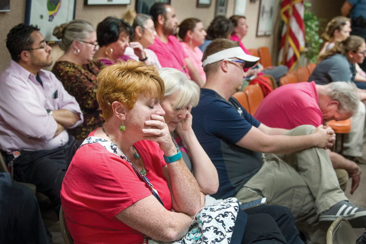Members of the audience, mostly teachers and paraprofessionals, react to the 3-2 vote by the Pueblo school board to reject a recommendation for pay increases. (Chris McLean, The Pueblo Chieftain)
