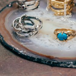 """<a href=""""http://www.rilanyc.com/rings/lava-stack-set"""">Lava Stack Set Rings</a>, from $95 (left); <a href=""""http://www.rilanyc.com/rings/single-stone-lava"""">Single Stone Lava Ring</a>, from $90 (right); <a href=""""http://www.rilanyc.com/rings/lava-chain-ring"""">"""