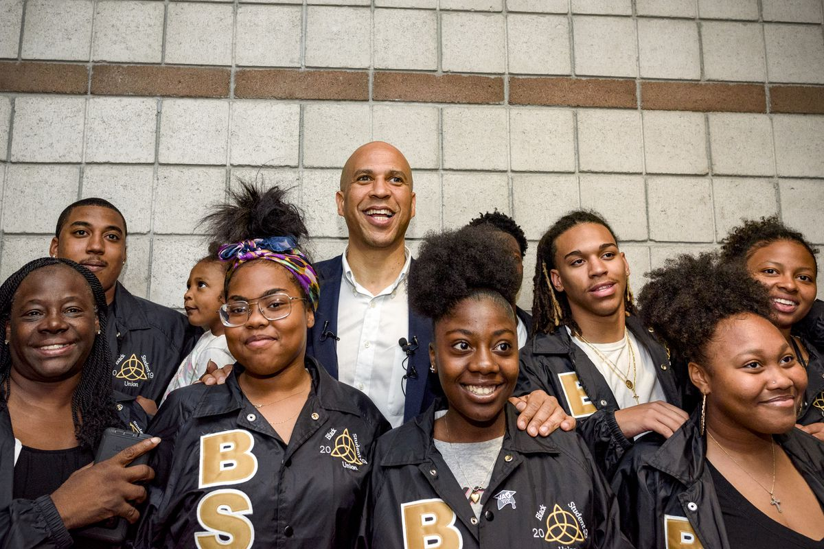 Sen. Cory Booker (D-NJ), poses for a picture with students from Cheyenne High School during a campaign event in Las Vegas, Nevada on May 28, 2109.