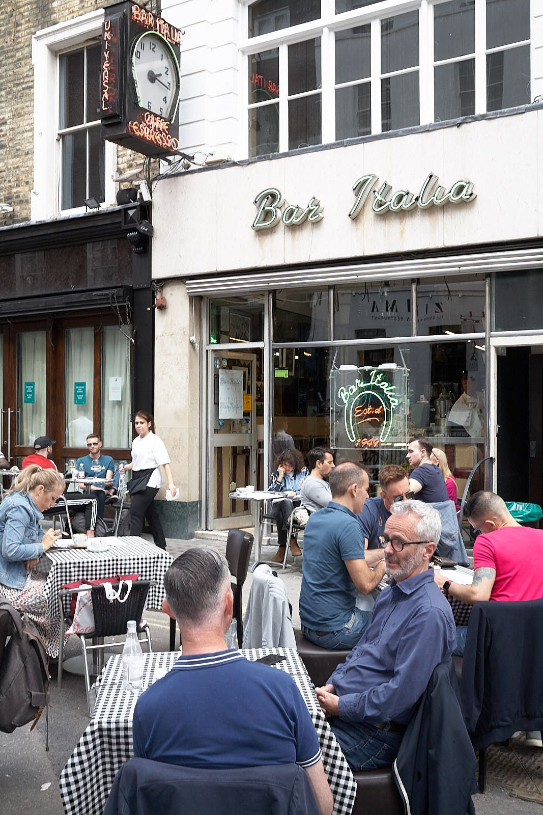 One of London's most famous cafes, Bar Italia, with customers occupying a new, extended terrace after lockdown restrictions were eased on hospitality venues in London