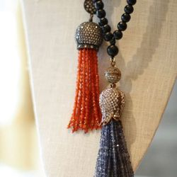 <bold>Live & Love Tassel necklace</bold>, $268: faceted stone tassel on a necklace of hand-strung wooden beads. Tassel available in emerald, ruby, sapphire, pyrite, labradorite, iolite, and carnelian.