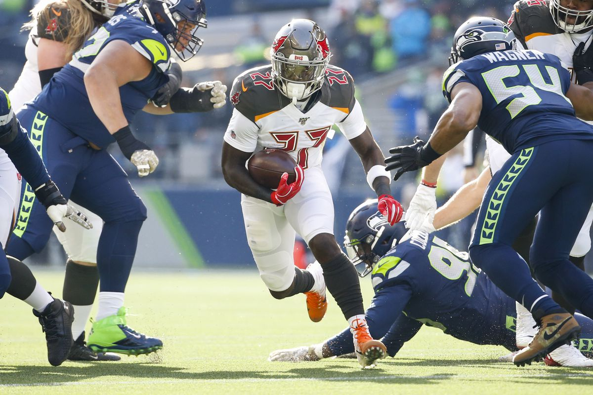Tampa Bay Buccaneers running back Ronald Jones rushes against the Seattle Seahawks during the first quarter at CenturyLink Field.