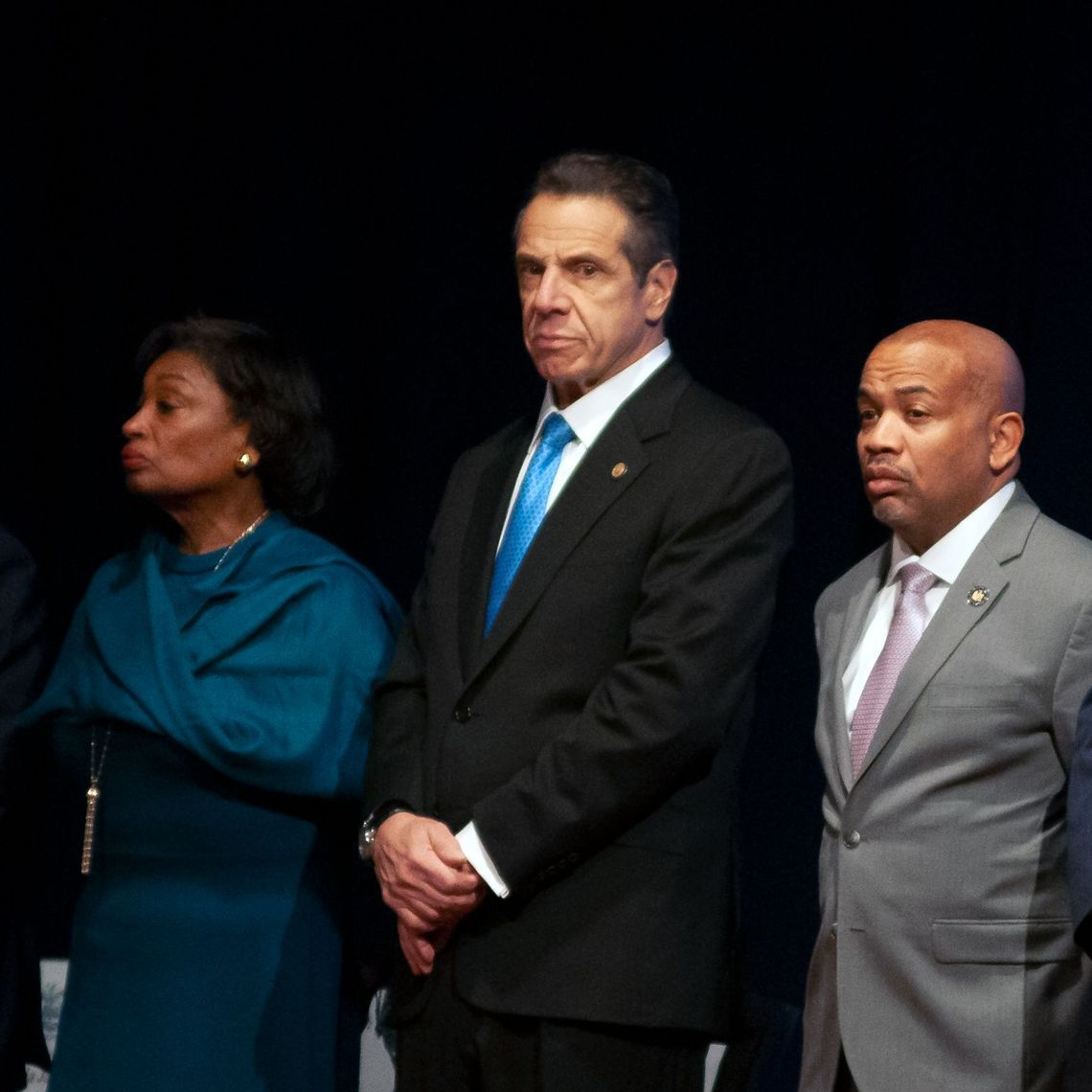 Governor Andrew Cuomo stands with Senate Majority Leader Andrea-Stewart-Cousins and Assembly Speaker Carl Heastie before delivering his State of the State address in Albany.