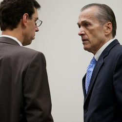 Martin MacNeill speaks to his attorney Randy Spencer, left, before proceedings in Provo's 4th District Court on Tuesday, Nov. 5, 2013. MacNeill is charged with murder in the 2007 death of his wife, Michele MacNeill.