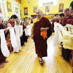 Tulku Choejor Rinpoche walks past members of the Tibetan Buddhist Temple they participate in annual Prayers for Compassion celebrations in Salt Lake City Thursday, July 3, 2014. The three-day festival offers members of the Salt Lake community a chance to observe, support and participate in a beautiful around-the-clock ritual generating compassion and loving-kindness on behalf of all sentient beings.
