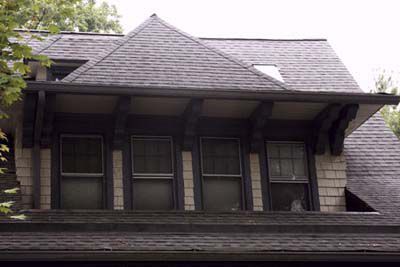 Roof with an inset dormer and four windows.