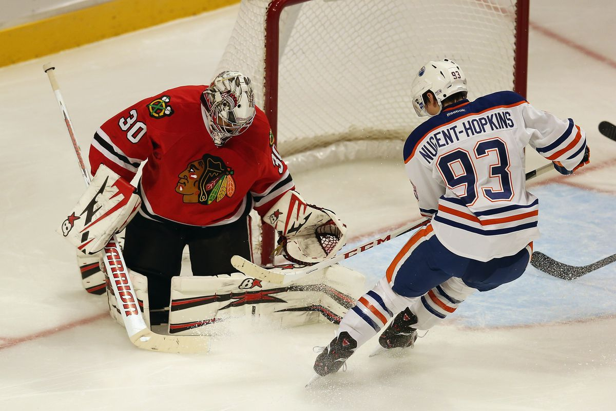 Ryan Nugent-Hopkins is stopped by Ray Emery