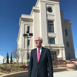 Elder Larry Y. Wilson, a General Authority Seventy, speaks with reporters after a tour of the Cedar City Temple.
