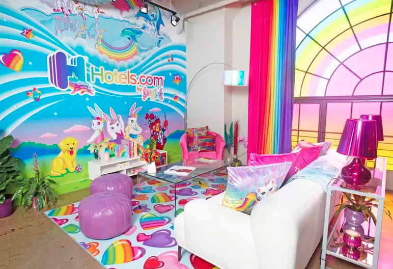 A room with a bright colored wall mural, rainbow curtains and an area rug with rainbow hearts on it.