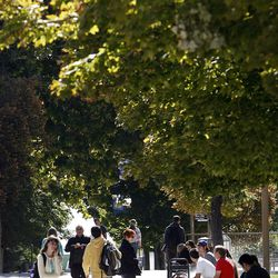 People walk on campus at Brigham Young University in Provo, Monday, Oct. 8, 2012.