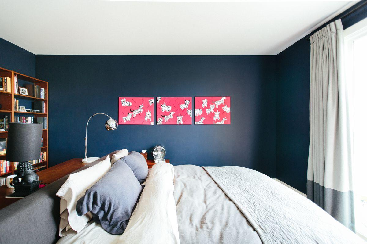 A dark blue bedroom.