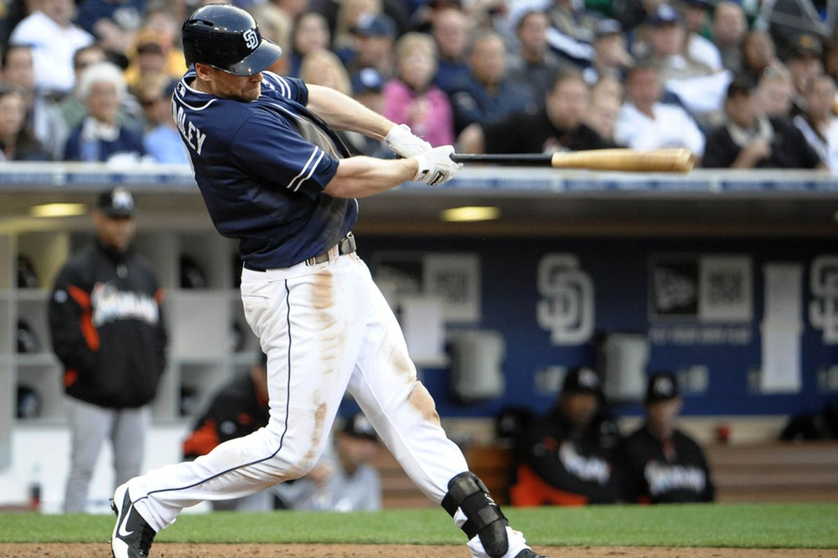 SAN DIEGO, CA - MAY 5: Chase Headley #7 of the San Diego Padres hits an RBI single during the sixth inning of a baseball game against the Miami Marlins at Petco Park on May 5, 2012 in San Diego, California.  (Photo by Denis Poroy/Getty Images)