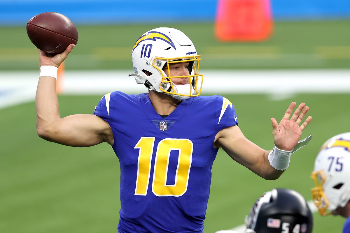 Justin Herbert #10 of the Los Angeles Chargers attempts a pass against the Atlanta Falcons during the first quarter at SoFi Stadium on December 13, 2020 in Inglewood, California.